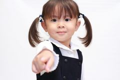 Japanese girl pointing at the camera in formal wear Stock Images