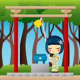 Japanese Girl Praying. Little Japanese girl with yukata praying on a Shinto shrine ringing a Suzu bell to call the spirits Stock Photos