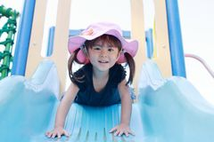 Japanese girl on the slide. 3 years old Royalty Free Stock Images