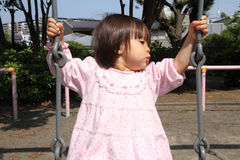 Japanese girl on the swing Royalty Free Stock Photo