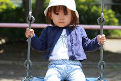 Japanese girl on the swing Royalty Free Stock Image