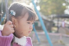 Japanese girl on the swing stock photography