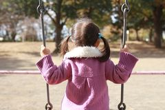 Japanese girl on the swing. 3 years old Stock Photography