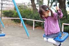 Japanese girl on the swing. 3 years old Stock Photos