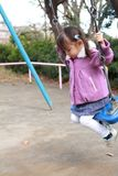 Japanese girl on the swing. 3 years old Royalty Free Stock Images