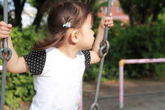 Japanese girl on the swing. 2 years old Stock Photography