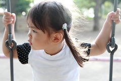 Japanese girl on the swing. 2 years old Royalty Free Stock Photo