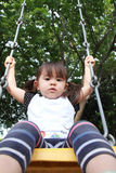 Japanese girl on the swing Stock Image