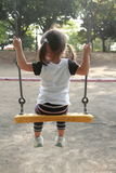 Japanese girl on the swing Royalty Free Stock Photography