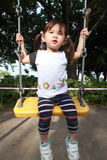 Japanese girl on the swing Stock Images