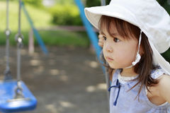 Japanese girl on the swing Royalty Free Stock Images