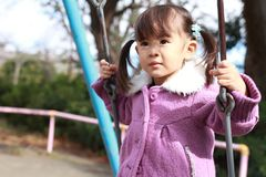 Japanese girl on the swing Stock Photos
