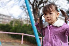 Japanese girl on the swing. 3 years old Royalty Free Stock Photos