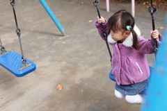 Japanese girl on the swing. 3 years old Stock Images