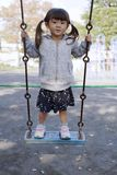 Japanese girl on the swing royalty free stock photos