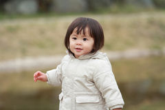 Japanese girl taking a walk in the park Stock Images