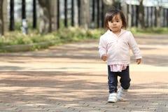 Japanese girl taking a walk Royalty Free Stock Photo