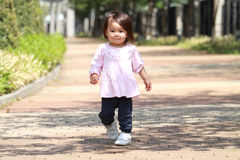 Japanese girl taking a walk Royalty Free Stock Photography