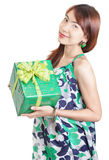 Japanese girl w Christmas gift. Attractive and congenial or friendly standing oriental Asian Japanese-looking girl with Christmas present in her hands. Isolated Royalty Free Stock Photography