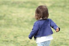 Japanese girl walking on the grass Stock Image