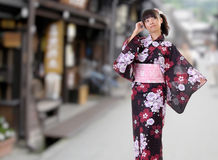 Japanese girl walking on street Royalty Free Stock Images