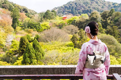 Japanese girl wear Kimono. Young Japanese girl wear Kimono looking to beautiful view of Tokyo, Japan royalty free stock photos