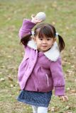 Japanese girl playing catch Royalty Free Stock Photos