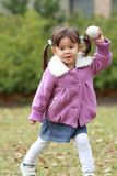 Japanese girl playing catch. Japanese girl 3 years old playing catch stock photography