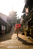 Japanese girl in Yukata with red umbrella in old town  Kyoto Royalty Free Stock Photos