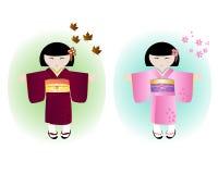 Japanese girls. Two japanese girls dressed in seasonal kimonos for autumn and spring Royalty Free Stock Photo