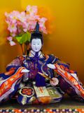 Japanese girls day Emperor doll. Girls day, called Hinamatsuri, doll display in Japan. Vibrant, colorful Emperors doll with sakura cherry blossoms on tatami Stock Photography