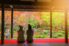 Japanese girls in Enkoji temple enjoy Autumn colorful garden Royalty Free Stock Photography