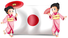 Japanese girls and flag Royalty Free Stock Image