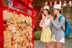 Japanese girls prayers on wooden plaques ema Royalty Free Stock Photo