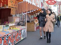 Japanese girls walking on street market. Nagoya. Japan royalty free stock photo