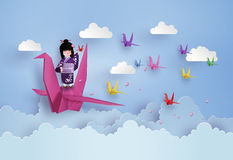Japanese girls wearing national dress and origami bird flying royalty free illustration
