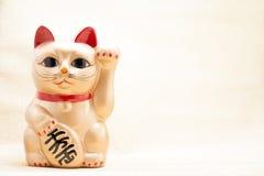 Japanese golden beckoning cat called Manekineko Royalty Free Stock Image