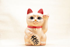 Japanese golden beckoning cat called Manekineko. Also known as a lucky cat royalty free stock photography