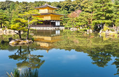 Japanese golden pagoda. And reflex on water Stock Photo