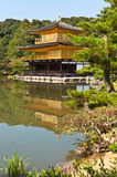 Japanese golden pagoda. And reflex on water Royalty Free Stock Images