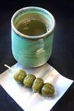 Japanese green tea and matcha Dango dessert. Hot Japanese green tea and Dango, Japanese dessert which made from matcha green tea, traditional dessert from Uji Stock Photography