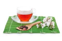 Japanese green tea and sakura branch Stock Photo
