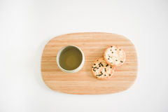 Japanese green tea and two rice crackers on a tray Stock Images