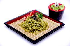 Japanese Greentea Soba Noodles with Dipping Sauce , Cha Soba iso. Lated on White Background with Clipping Path royalty free stock images