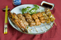 Japanese Grilled Food on a Stick. Plate Stock Photos