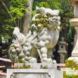 Japanese guardian lion statue. Infront of a shrine Stock Photos