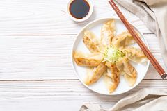Japanese gyoza or dumplings snack. With soy sauce stock image
