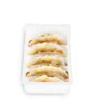 Japanese gyoza in white box on isolated white background Royalty Free Stock Images