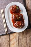 Japanese hambagu steak with sauce close-up on a white plate. Ver Stock Photography