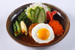 Japanese hamburg steak with fried egg and gravy isolated on whit Stock Photography